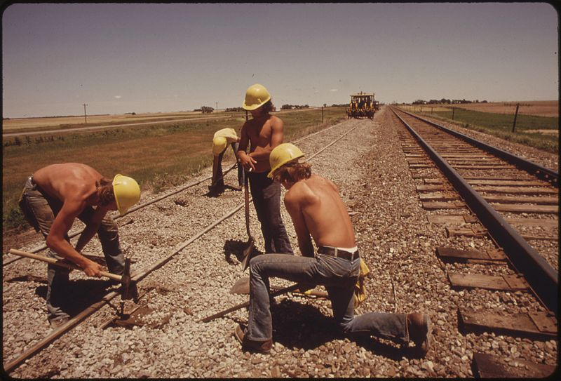 Source: http://en.wikipedia.org/wiki/File:RAILROAD_WORK_CREW_IMPROVES_THE_TRACKS_AND_BED_OF_THE_ATCHISON,_TOPEKA_AND_SANTA_FE_RAILROAD_NEAR_BELLEFONT,_KANSAS..._-_NARA_-_556012.jpg